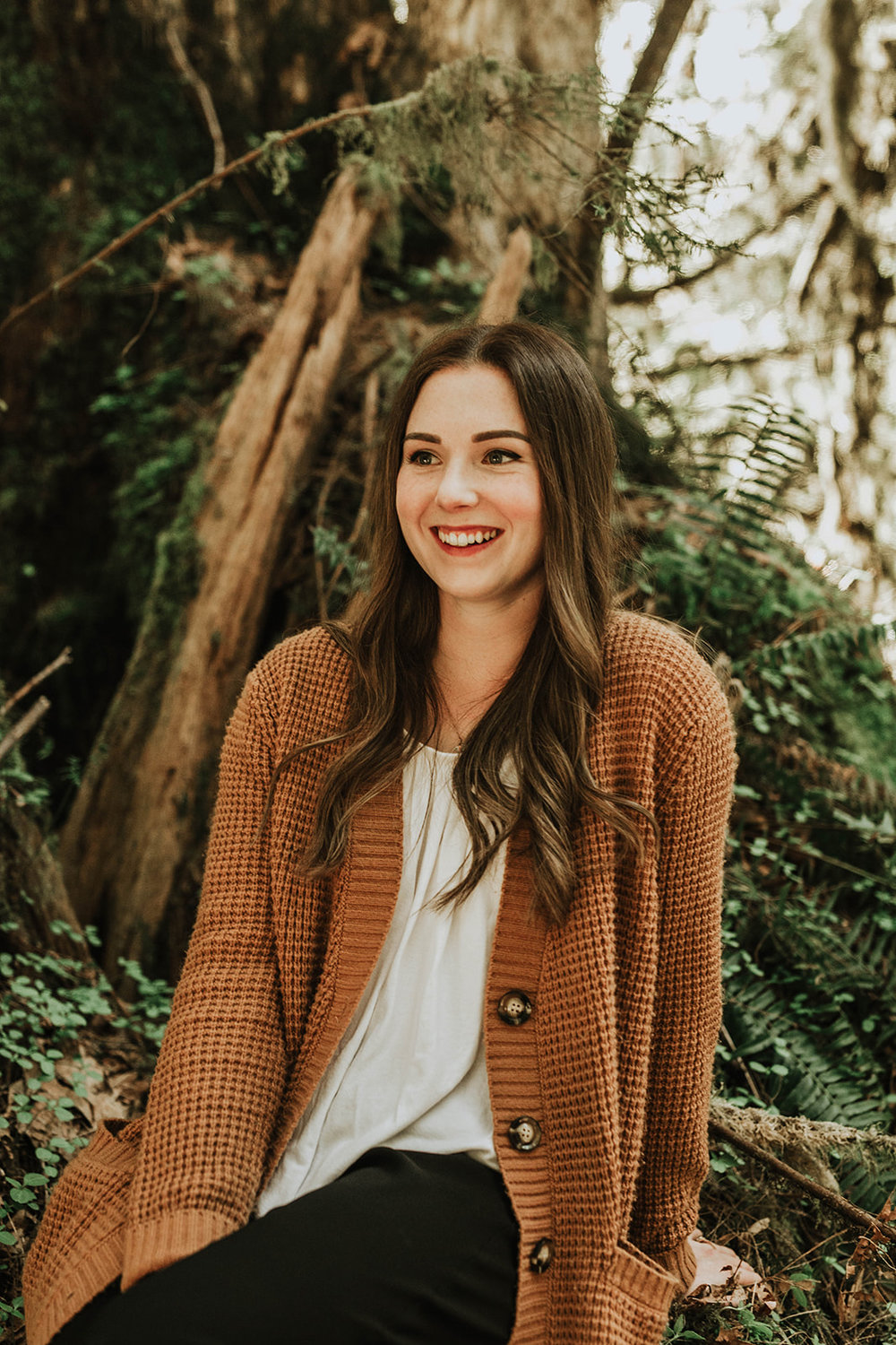 pretty girl smiling in forest