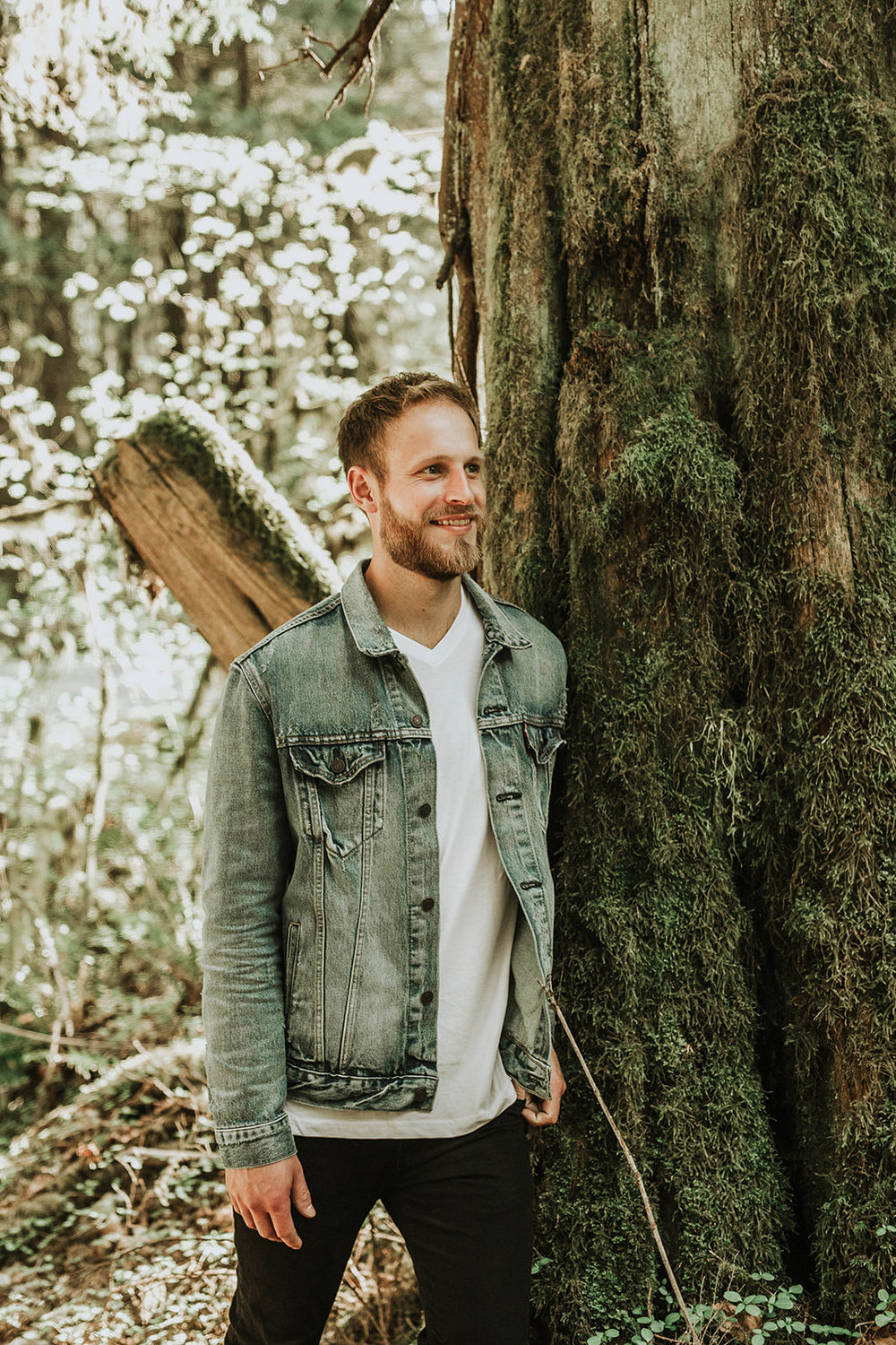 man smiling in forest