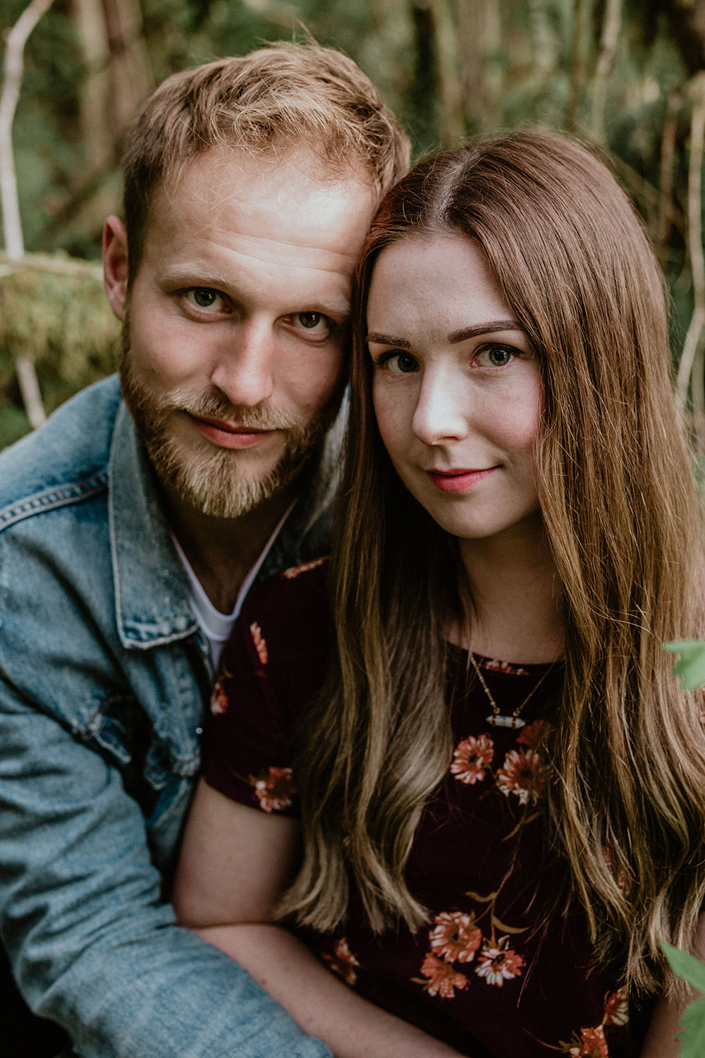 young couple looking into camera