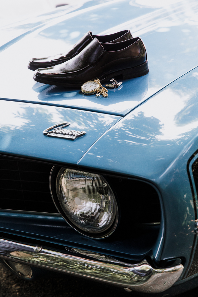 groom's shoes on car