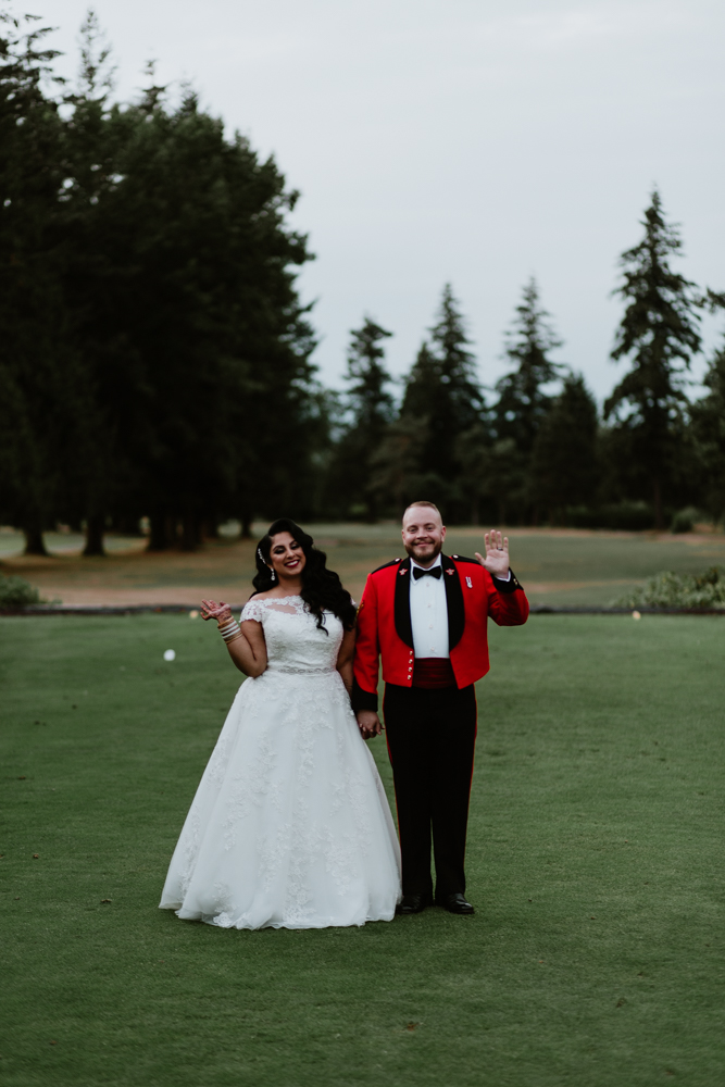 happy bride and groom at golf course