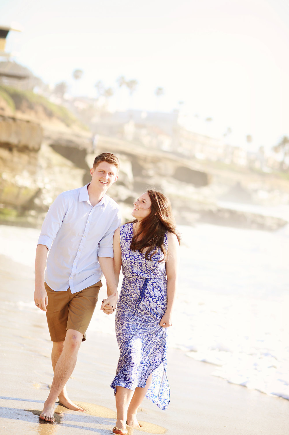 Young couple strolling on the beach. Great beach portrait.