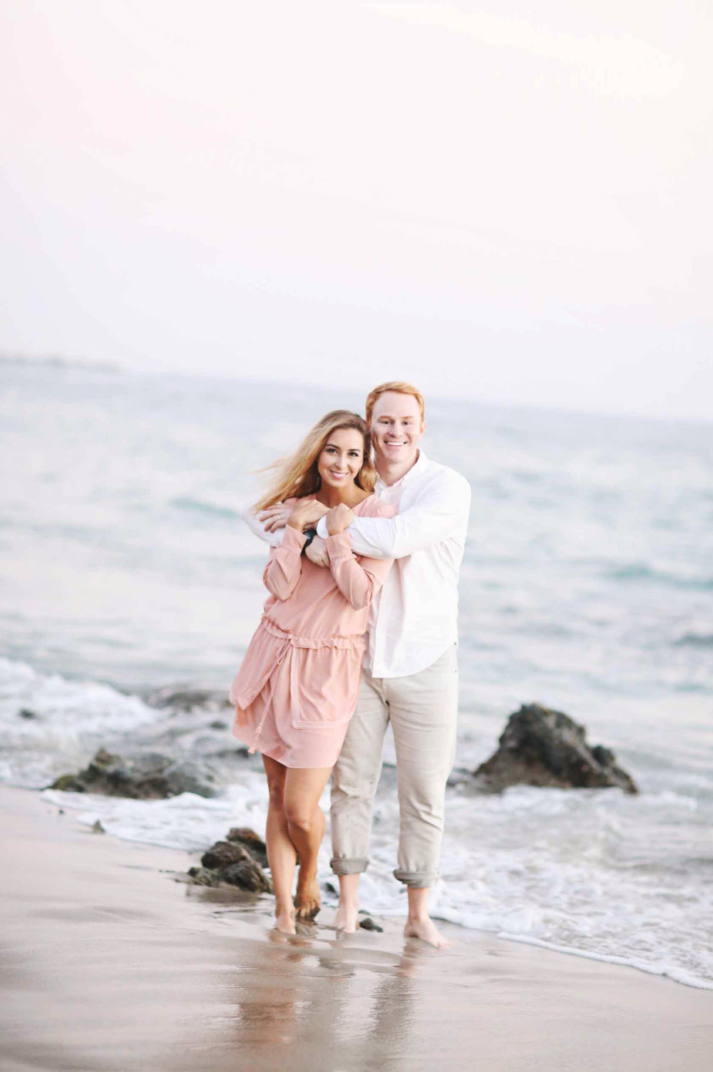 Engagement photo of a couple at an Orange County beach