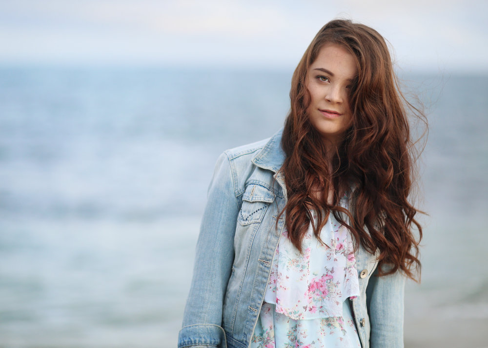 Young girl at San Clemente Beach, Orange County. Senior portraits at the beach.