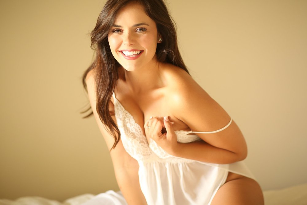 Sexy model with a beautiful smile in a boudoir photo