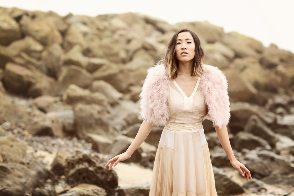 Fashion Blogger Amanda from Feast Fashion Faves poses in a pink evening gown on the beach in San Clemente Orange county.