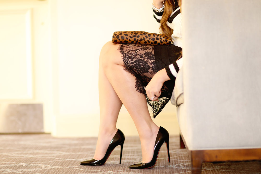 Fashion Blogger wearing patten leather black pumps.  Fine art photo