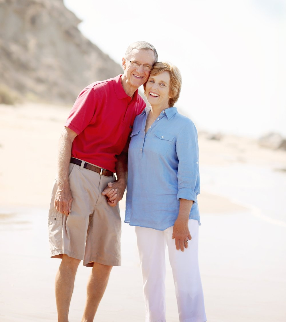 husband and wife at the beach for a portrait.  Older couple at San Clemente Beach orange county