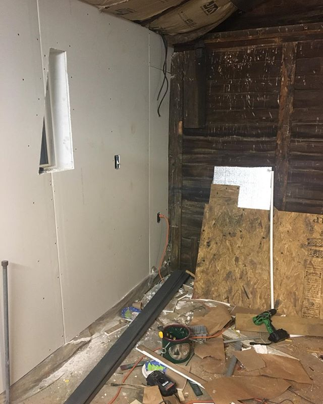Progress is slow, but we have lights and drywall is ready for mud.  #studio #patience #music #creativespace #construction #drywall