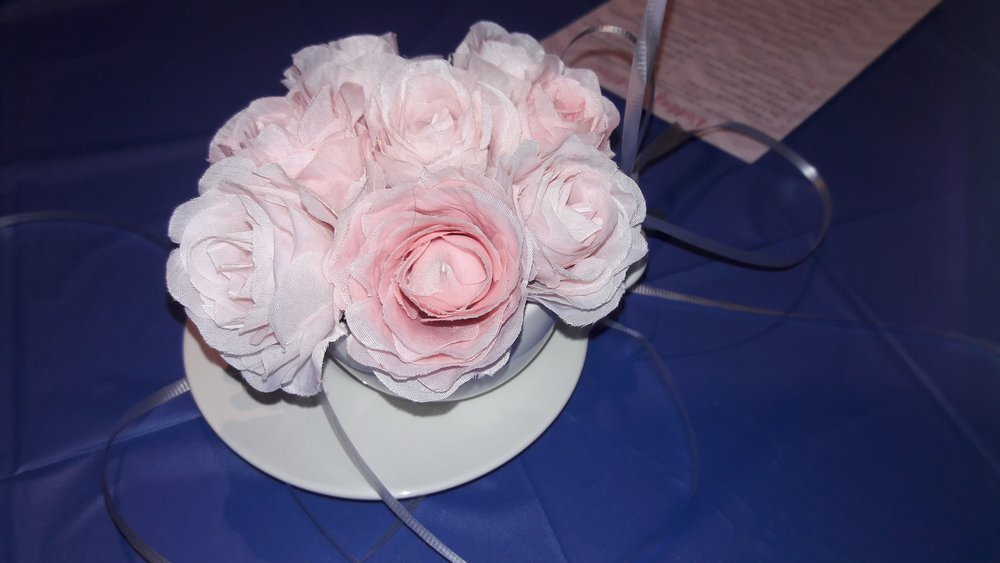 My future mother-in-law made lovely centerpieces that featured silk flower arrangements in teacups.