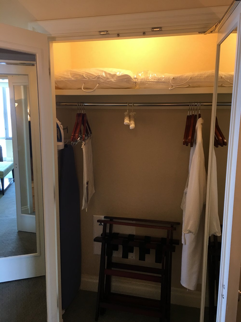 Closet was spacious and included extra robes, ironing board, and linens.