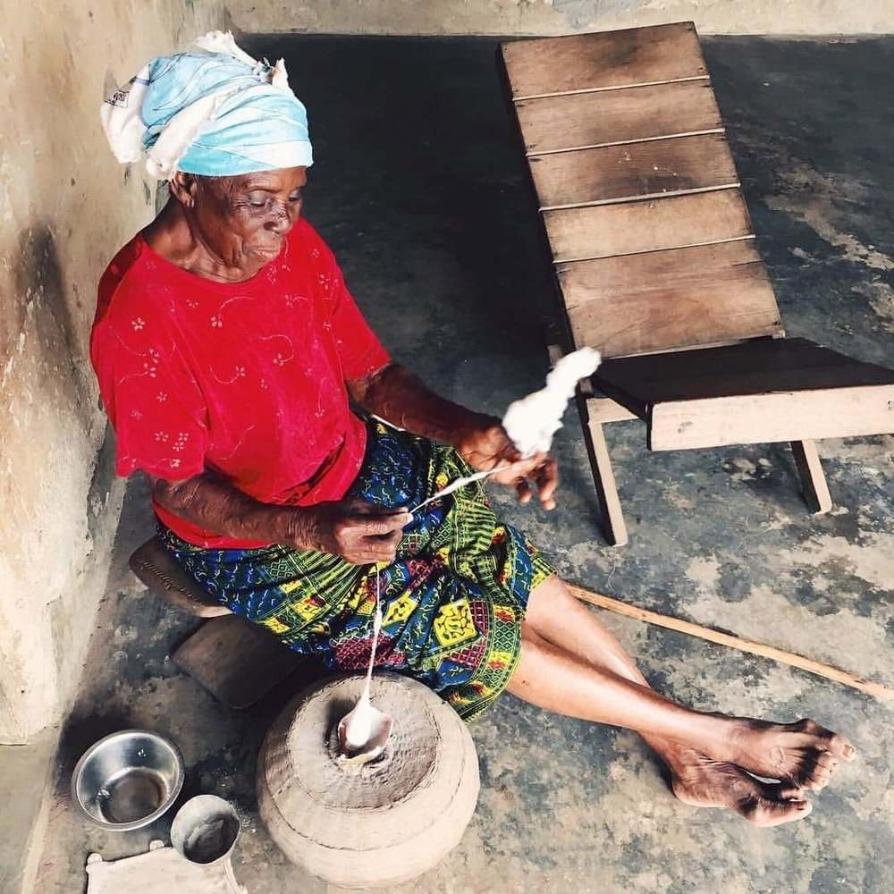 Nana - Pictured: Nana making yarn out of wool. Clare lived in Nana's household along with Nana's sister, Mame. According to Clare, she is the sweetest. When Clare left Ghana, Nana gifted her a spool and the stone that she used to weight the wool then pull it into a strand.Photo by Clare Cutler