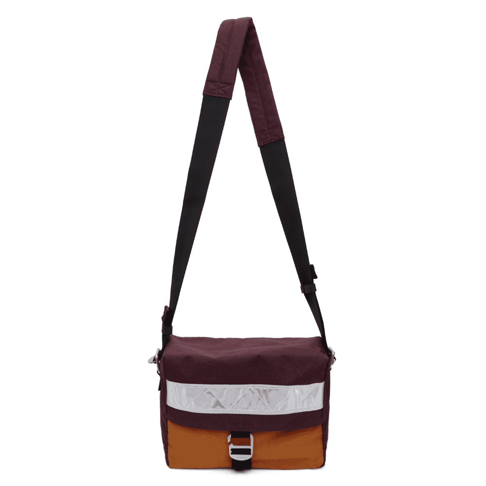 ACNE STUDIOS CONTRAST BAG - This is called the contrast bag but the colors, including the reflective stripe, are actually pretty subtle. Utilize this bag and give your outfit that extra touch of color.SELLOUT RISK: LOW MED HIGHPurchase now at ssense.com for $230.00