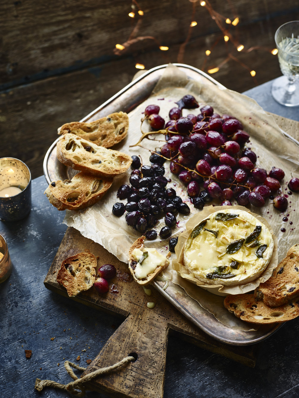 Baked Tunworth and Roast Grapes Photograph Maja Smend Prop Styling Olivia Wardle Recipe Olivia Spurrell