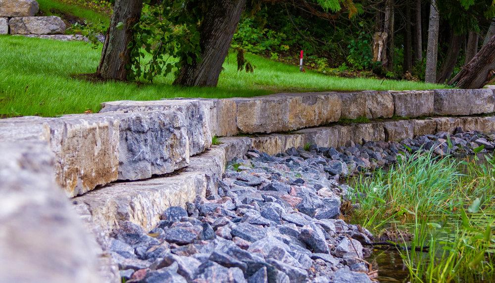Rockwall Against Pond