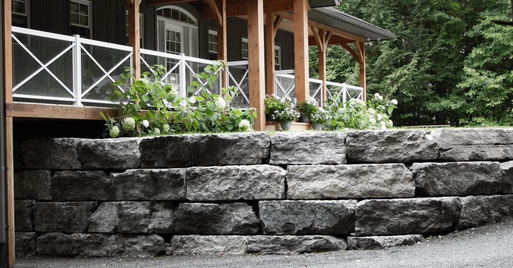Stone Retaining Wall Near Driveway