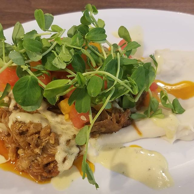 Great lunch today with my Grandma and cousin. Milk braised pork with a garnish of tomato & watermelon featuring sweet corn sauce white bean puree and pea shoots #local cooking #cupnsaucer @spitzerlaura