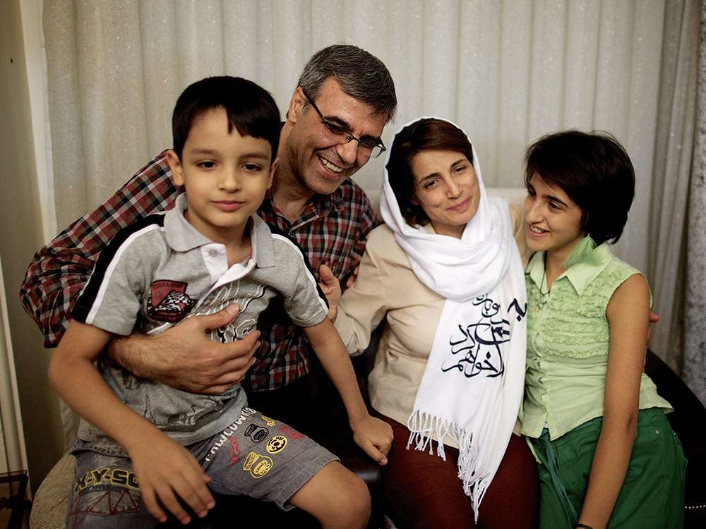 Nasrin Sotoudeh poses for a photo with her husband, Reza Khandan, her son, Nima, and her daughter, Mehraveh, at their home in Tehran on Sept. 18, 2013.