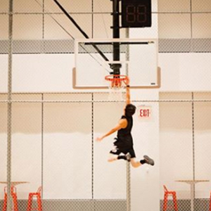Akin Akman Instagram doing a slam dunk with lots of air