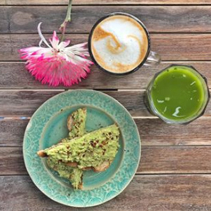 Yoga Girl Instagram meal with cappuccino matcha and pink flowers