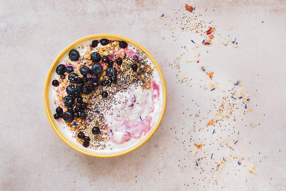 Acai bowl with yogurt berries chia seeds sesame seeds and granola