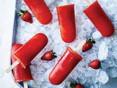 Strawberry sangria ice pops in bucket of ice