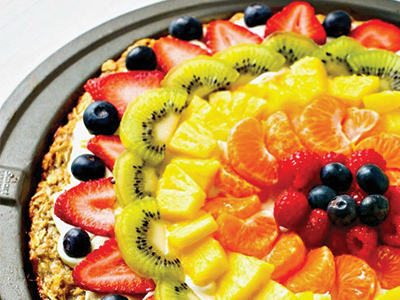 Fruit pizza with blueberries kiwis oranges strawberries pineapples and granola