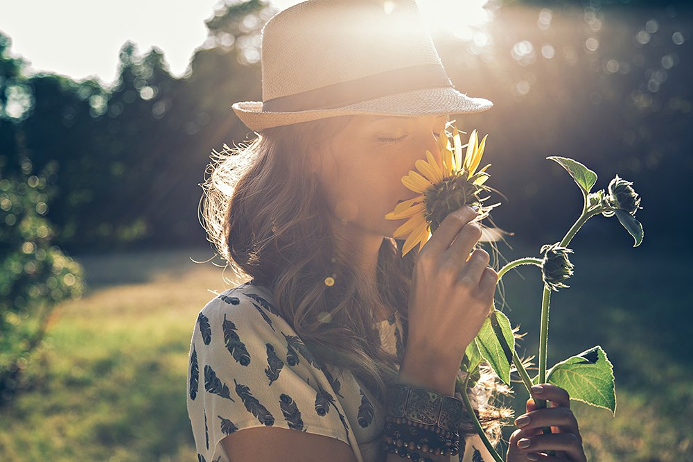 woman-smelling-sunflower.jpg
