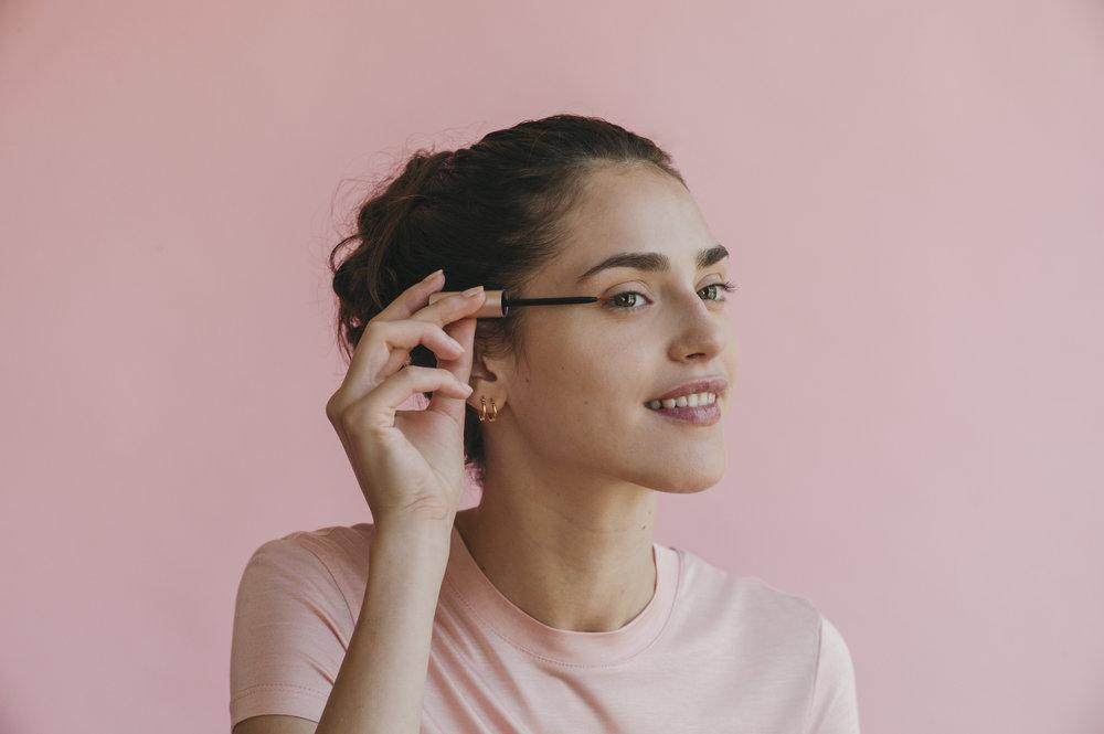 Woman applying Vegamour eye lash serum