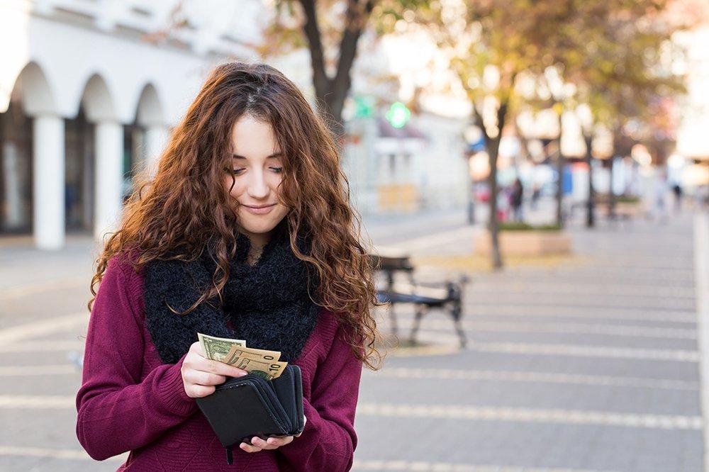 Woman-Taking-Money-From-Wallet.jpg