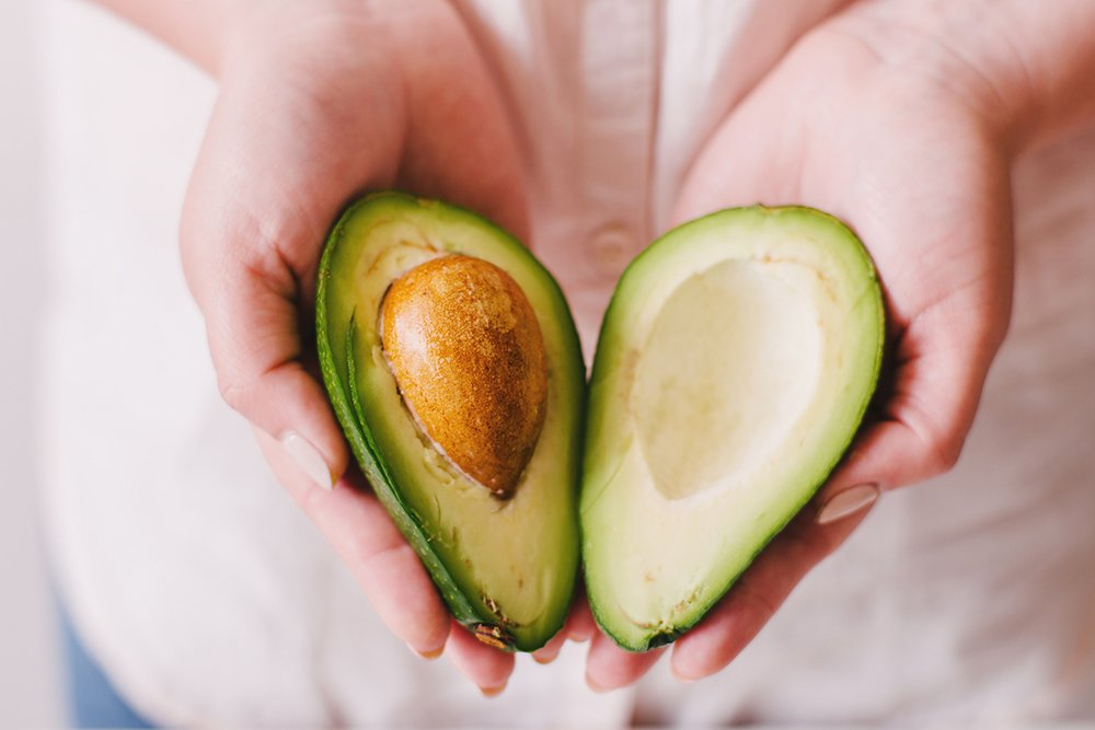 Woman-holding-avocado.jpg