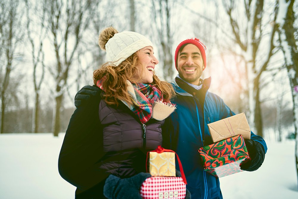 Guy-and-girl-holding-gifts-smiling.jpg