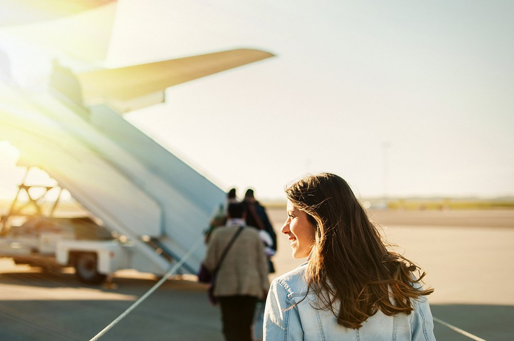 Woman-walking-towards-plane.jpg