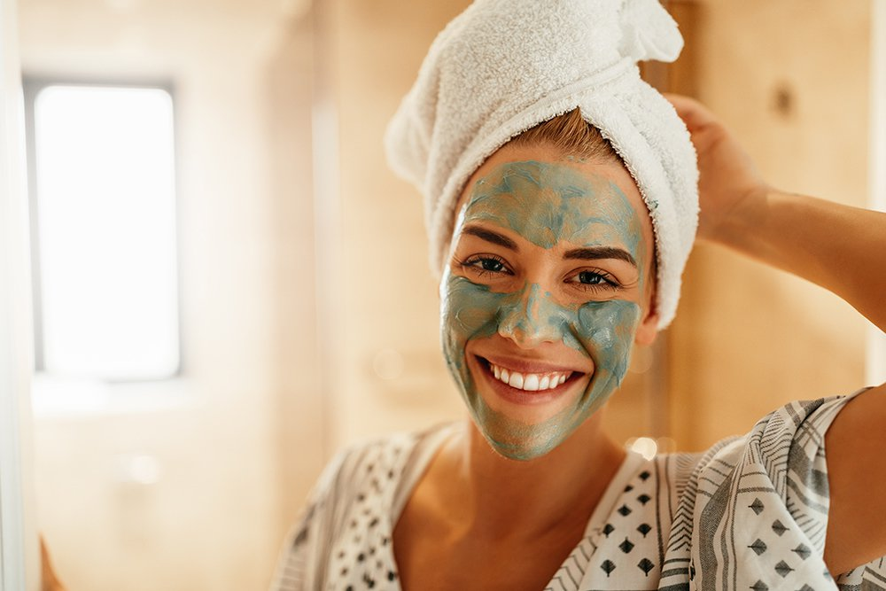 Woman-smiling-with-face-mask-on.jpg