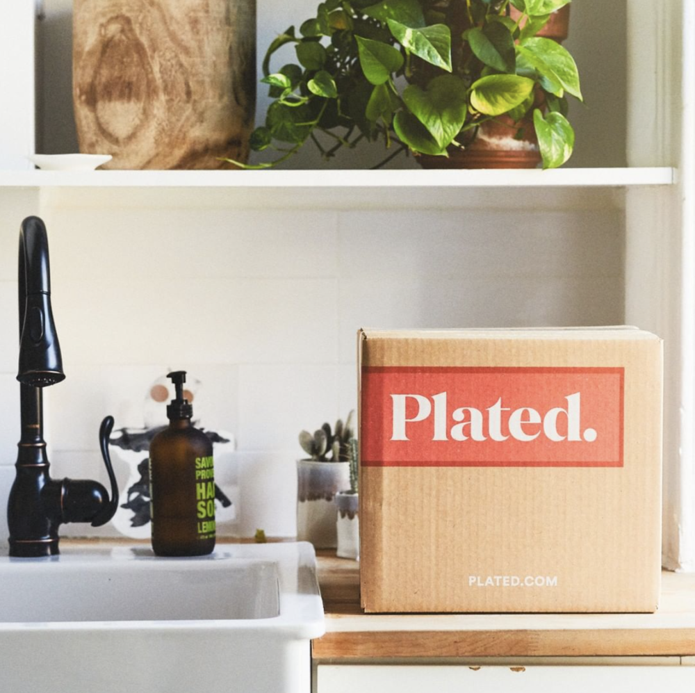 plated-meal-delivery-box-on-counter-with-plant