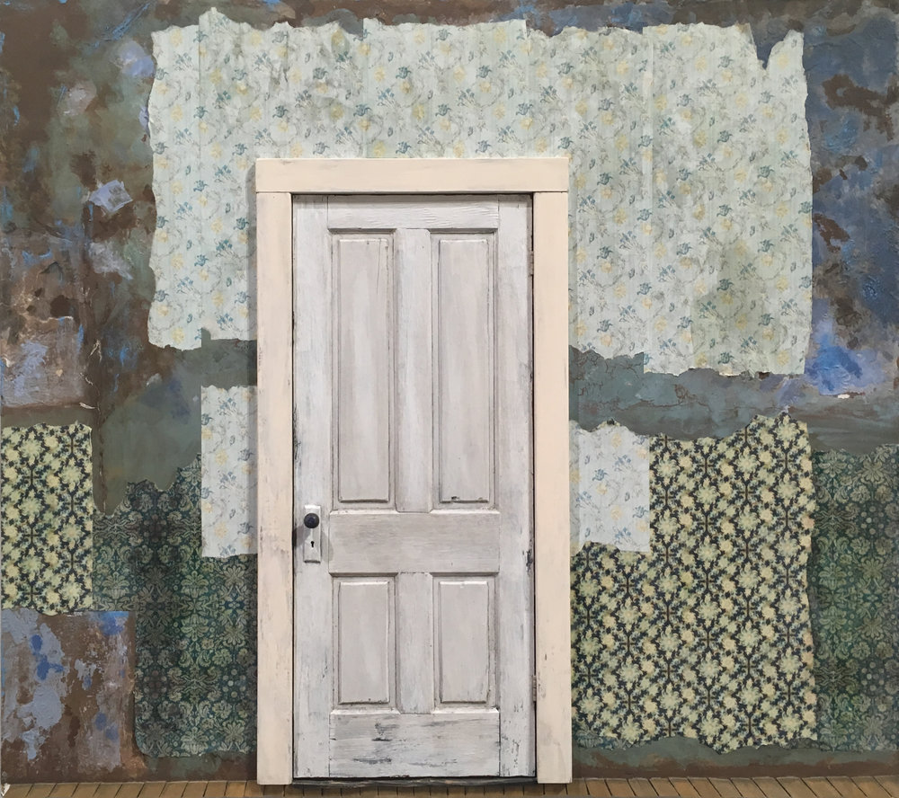 White Door with Tattered Wallpaper