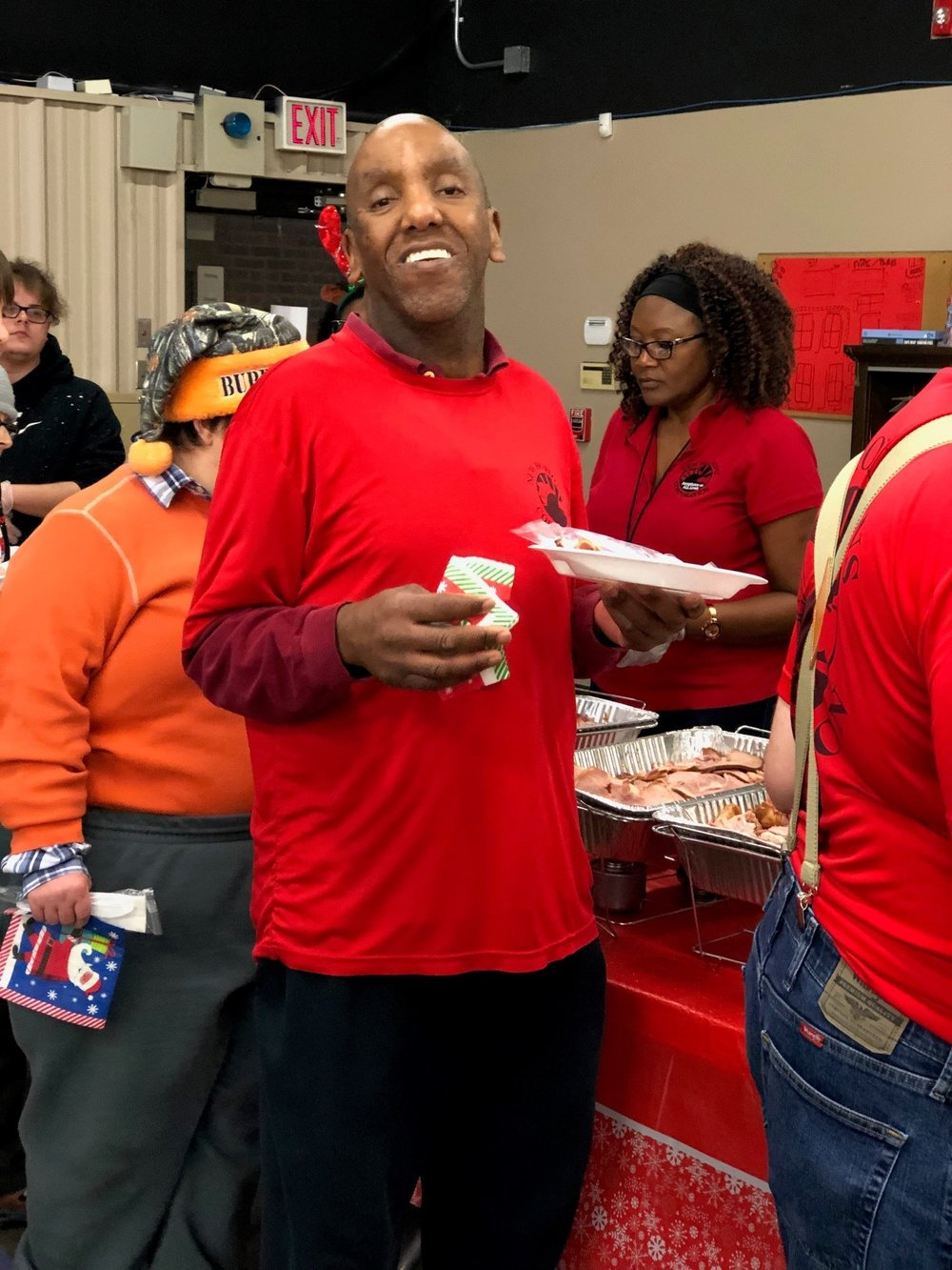 Michael is all smiles as usual. Aisha in the background there doing some manual labor.