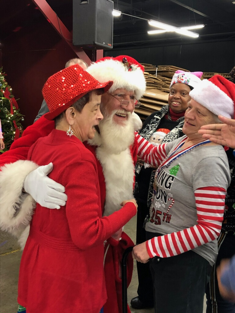Elaine and Sonja greeting Santa!