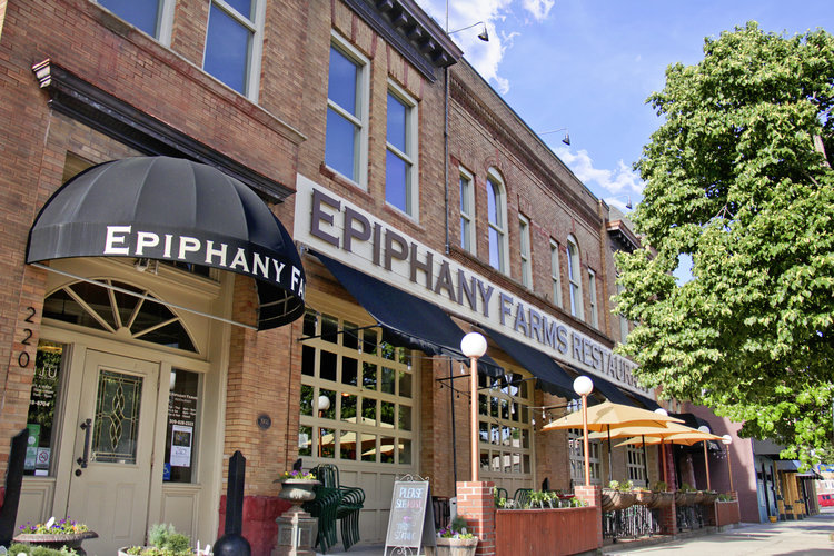 Epiphany Farms    220 E. Front Street  Bloomington, IL 61701  309-828-2323   Serving Dinner Only, Tuesday – Saturday   Tuesday – Thursday: 4pm – 9pm  Friday & Saturday: 4pm – 10pm   Epiphany Farms Hospitality Group  is committed to supporting, growing, and showcasing a thriving, local food culture. We serve as an anchor for a network of local food producers by increasing community awareness of locally sourced ingredients, increasing interest in the culinary traditions of the midwest, and providing a positive model for responsible stewardship of the land that nourishes us.  Please join the movement and learn more about us by visiting our farms, hosting events with us, dining at our restaurants, exploring our career opportunities, or hiring our Chefarmers® to talk at your next event.
