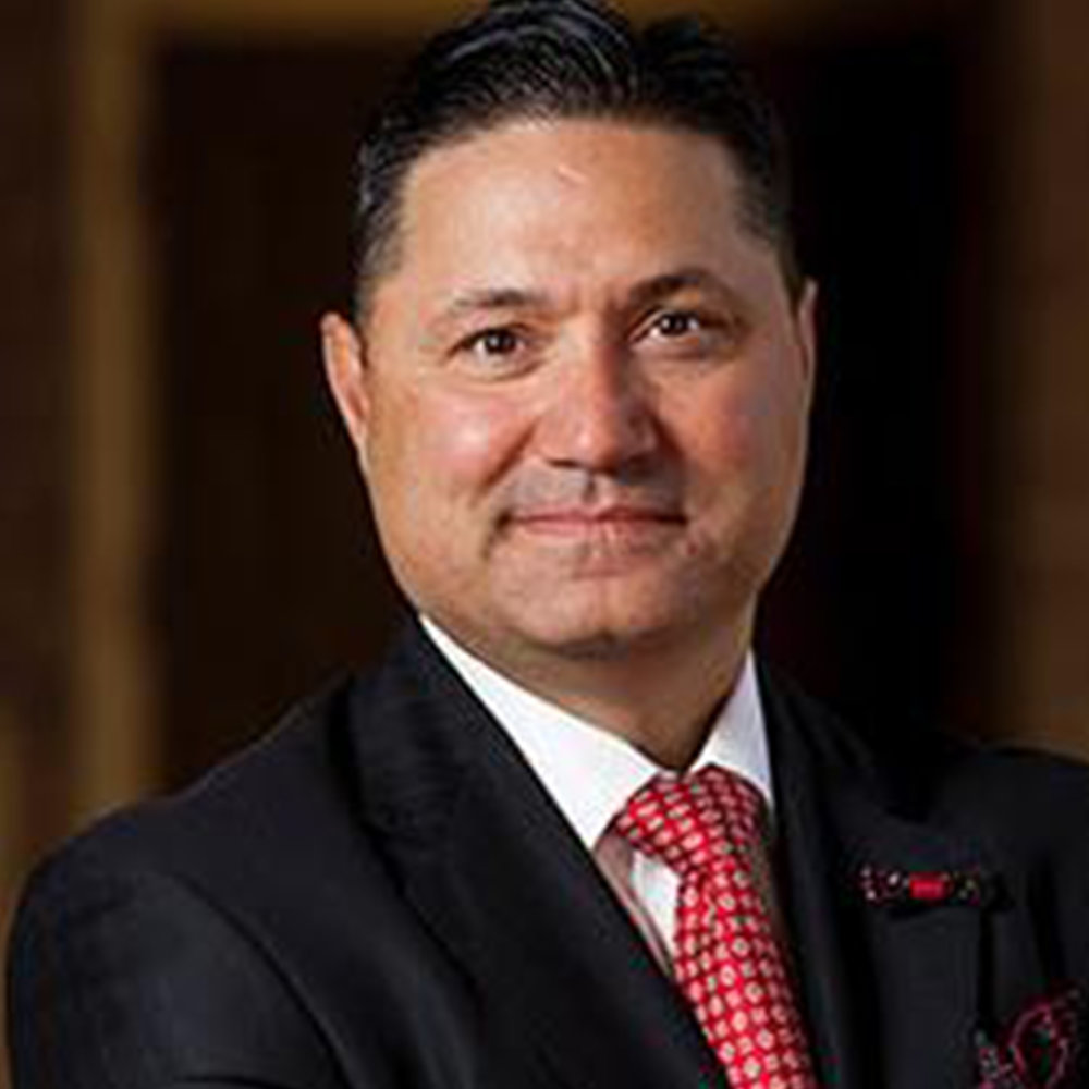 Dr. Juan Munoz   Dr. Juan Sanchez Muñoz was appointed as the president of the University of Houston-Downtown on Feb. 23, 2017. During his first year at UHD, Dr. Muñoz kicked off a major capital campaign; led the institution's recovery efforts during Hurricane Harvey; and presided over six commencement ceremonies with nearly 3,000 graduates.  Prior to arriving at UHD, Dr. Muñoz previously served as Texas Tech University's (TTU) vice provost for undergraduate education and student affairs, and senior vice president for institutional diversity, equity and community engagement.  Muñoz was awarded a Doctorate of Philosophy at the University of California, Los Angeles. Prior to his career in higher education, Muñoz was a secondary school teacher and also served as a sergeant in the U.S. Marine Corps. Muñoz is married to Dr. Zenaida Aguirre-Muñoz, and the couple has three sons, Joaquin Diego Muñoz, Cruz Santos Muñoz and Juan Amado Muñoz.
