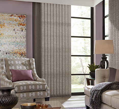 "expand your expectationsSophisticated Graber Vertical Blinds in fabric or vinyl vanes form a perfect top-to-bottom solution. Nearly 200 upscale, contemporary colors and patterns ensure that they provide an artful accent to the landscape that lies beyond your window. Use vertical blinds to make a bold color statement, coordinate with an existing color in your décor, or pair them with matching Graber 2"" Vinyl Horizontal Blinds. -"