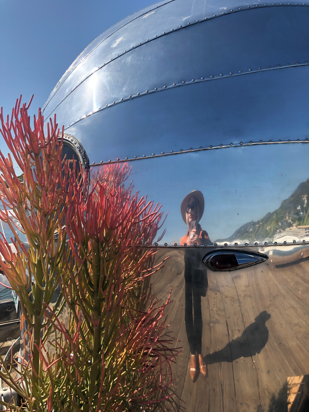 an airstream shop parked along the Malibu pier