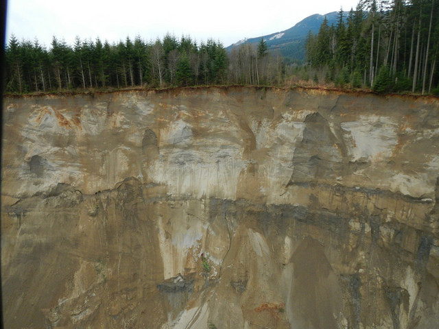 Actual view of the hill side that gave way near State Route 530 in Oso, WA. Photo by  Washington State Department of Transportation on Flickr