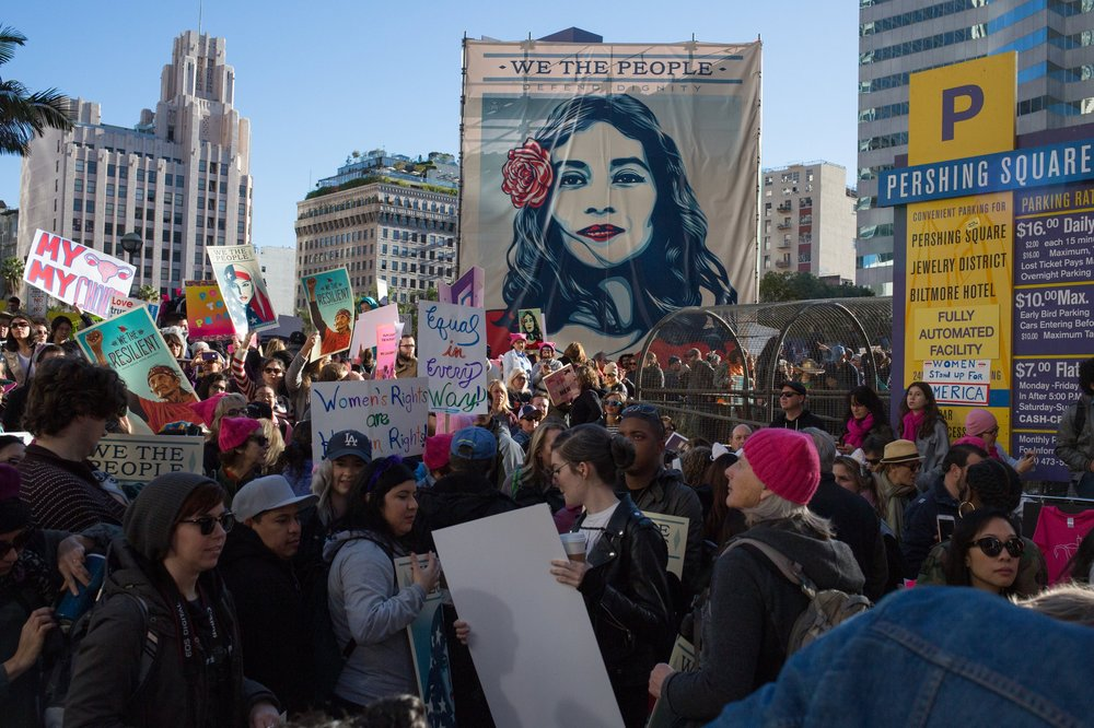 We the People: Defend Dignity banner at Perishing Square in downtown Los Angeles at the Women's March, 2017.