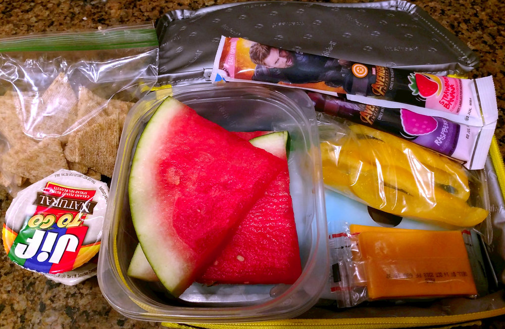 An example of some of the snacks are pictured here. Only the items that need to be kept cold are in a soft-sided cooler to save space.