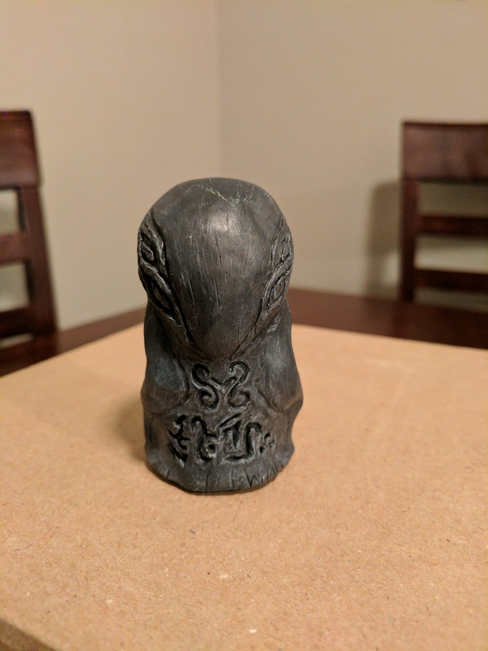 Mysterious graven idol, front