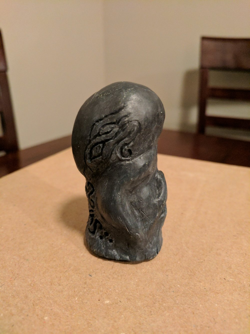 Mysterious graven idol, side