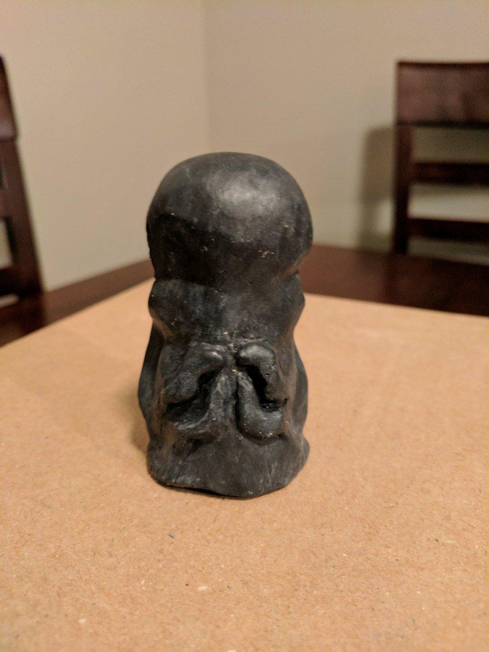 Mysterious graven idol, rear