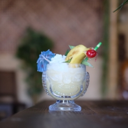 COCO BANANA— $14 - Fresh fruits blended with rich coconut flavor, premium aged rum, served with passion fruit vanilla bean whipped cream
