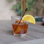 RUM OLD-FASHIONED — $11 - House selected premium aged rum, with just a touch of sugar and bitters, served on a large, chilly ice cube.